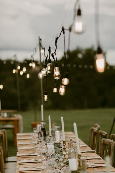 Edison Bulbs Wedding Lighting | Outdoor Boho Wedding at Chateau le Tour, France | Adam and Grace Photography | Head and Heart Films