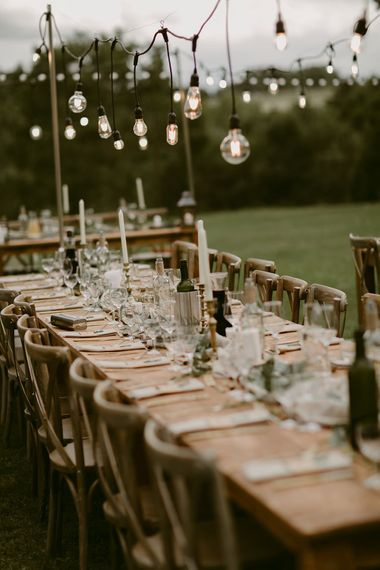 Trestle Tablescape | Festoon Lit Outdoor Boho Wedding at Chateau le Tour, France | Adam and Grace Photography | Head and Heart Films