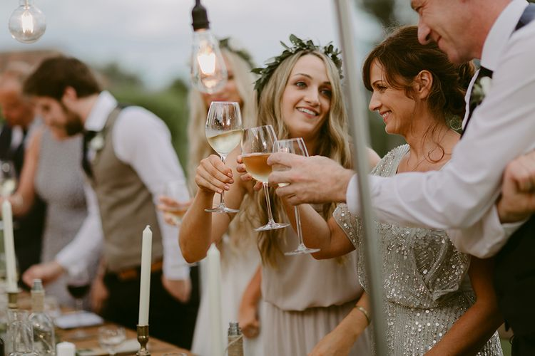 Cheers | Festoon Lit Outdoor Boho Wedding at Chateau le Tour, France | Adam and Grace Photography | Head and Heart Films