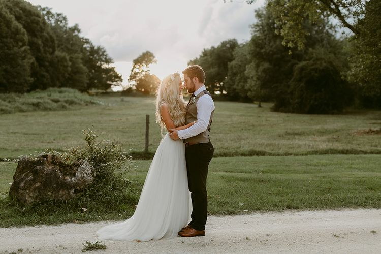 Golden Hour | Bride in Daalarna Bridal Gown | Groom in Waistcoat | Outdoor Boho Wedding at Chateau le Tour, France | Adam and Grace Photography | Head and Heart Films