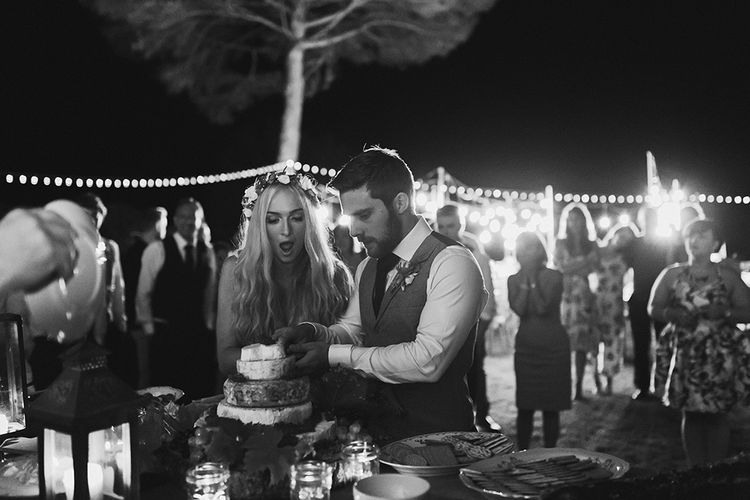 Cutting the Cake | Bride in Daalarna Bridal Gown | Groom in Waistcoat | Outdoor Boho Wedding at Chateau le Tour, France | Adam and Grace Photography | Head and Heart Films