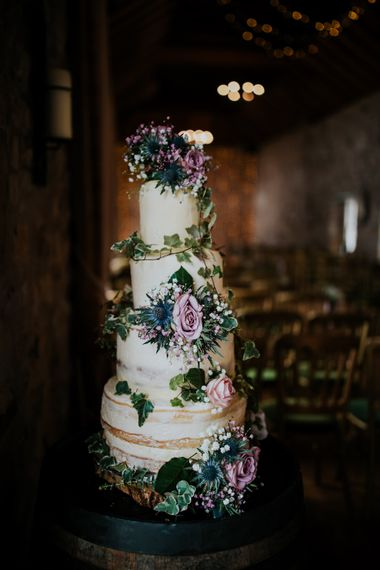 Semi Naked Wedding Cake With Thistles // Elegant Scottish Wedding At Kirknewton Stables With Lilac Colour Palette Semi Naked Wedding Cake And Images From Ross Alexander Photography