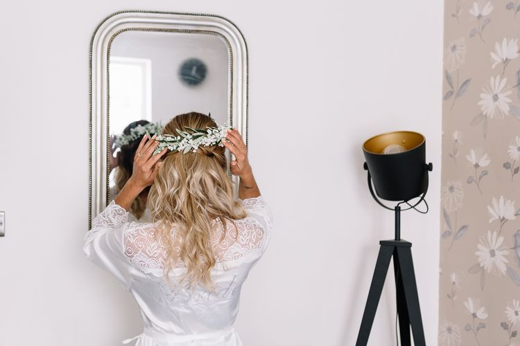 Wedding Morning Bridal Preparations with Bride in Getting Ready Rob Adjusting Her Flower Crown