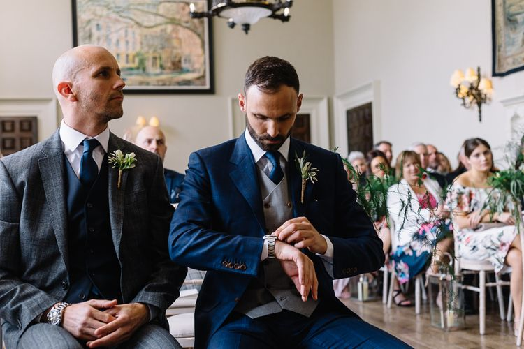 Groom in Bespoke Navy Check Suit at the Altar Checking His Watch