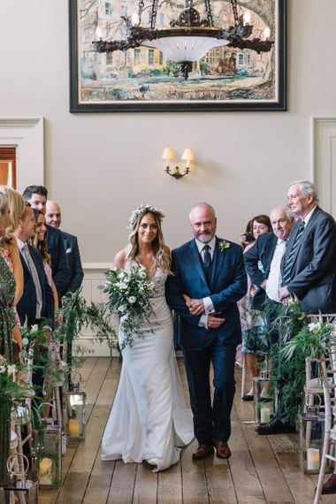 Wedding Ceremony Bridal Entrance with Bride in Fitted Mikaella Wedding Dress, Flower Crown and White and Green Wedding Bouquet