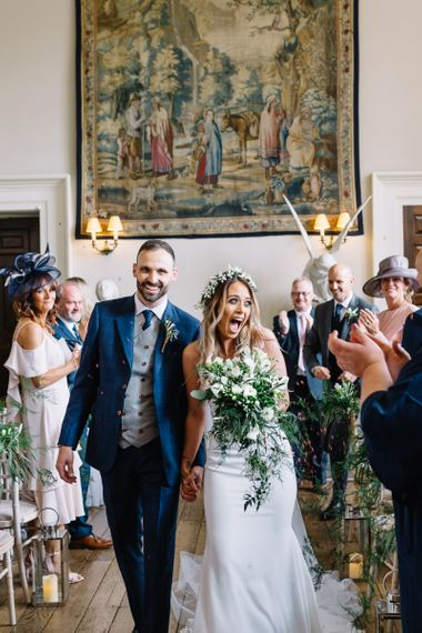 Wedding Ceremony Bride and Groom Exit in Mikaella Wedding Dress and Bespoke Navy Check Suit