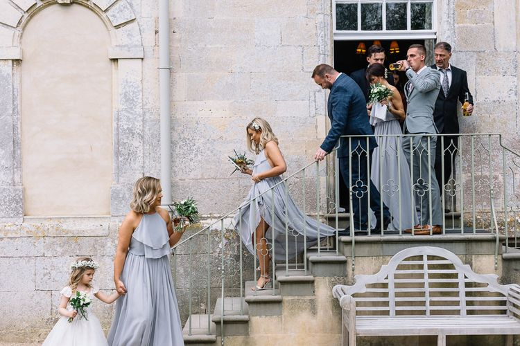 Wedding Party Exiting the Wedding Ceremony at Elmore Court Wedding Venue in Gloucestershire
