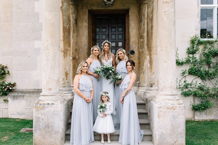Bridal Party Portrait with Bride in Fitted Mikaella Wedding Dress and Bridesmaids in Sliver Mist TH&TH Halterneck Dresses