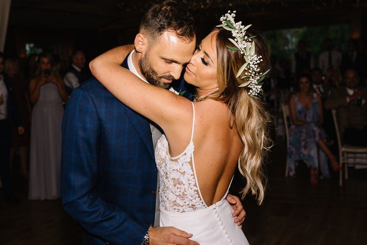 First Dance with Bride in Fitted Mikaella Wedding Dress  and Flower Crown and Groom in Bespoke Navy Check Suit