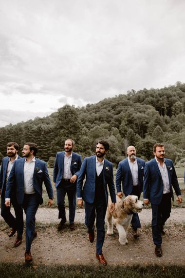 Groom and His Wedding Party In Navy Suits