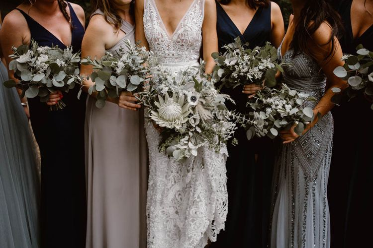 Bridal Party With Flower Bouquets In Blue and Green Bridesmaid Dresses