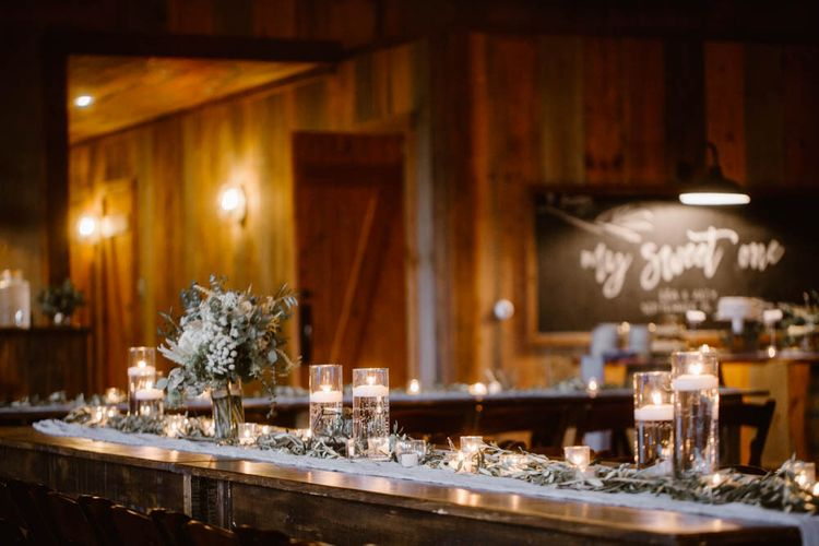 Candles Littered Over Wedding Tables For Reception