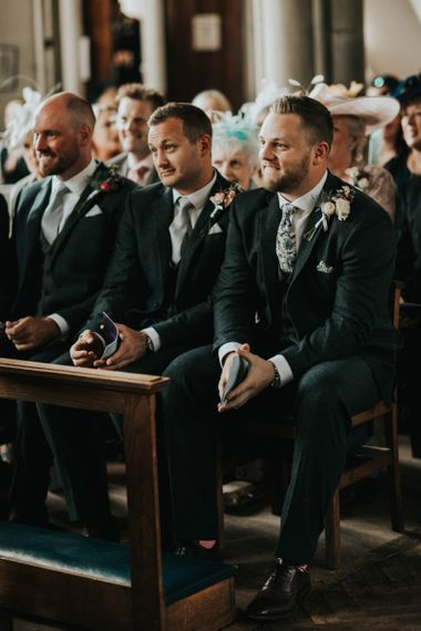 Groom waits for bride in church