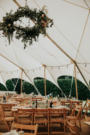 Festoon lighting in marquee wedding