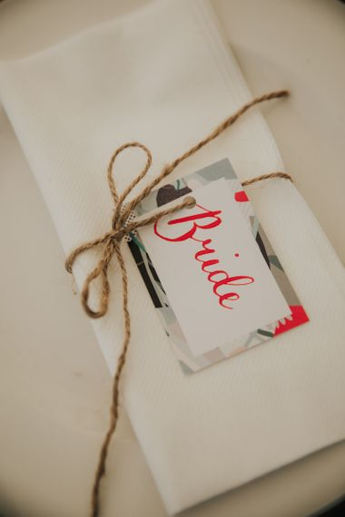 Wedding place setting in marquee