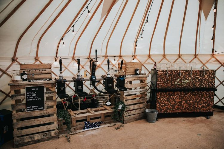 Rustic wedding bar in marquee