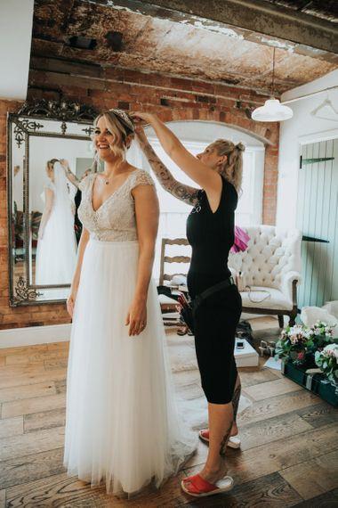 Bridal preparations in Stella York wedding dress