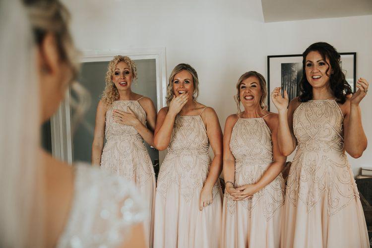 Bridesmaids see bride in Stella York wedding dress