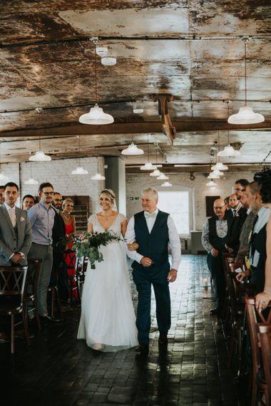 Bride in Stella York wedding dress walks down the aisle