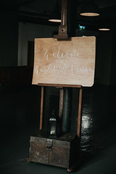 Wooden wedding sign at Industrial wedding