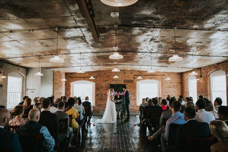 Bride in Stella York wedding dress at industrial wedding dress