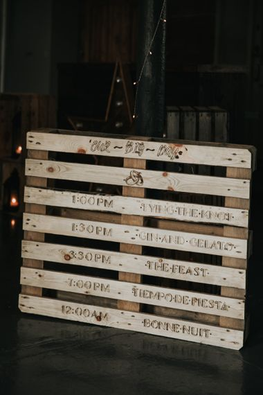 Wooden sign at Industrial style wedding