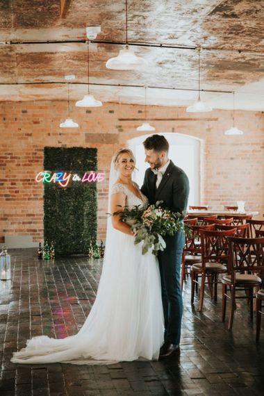Neon wedding sign at industrial wedding
