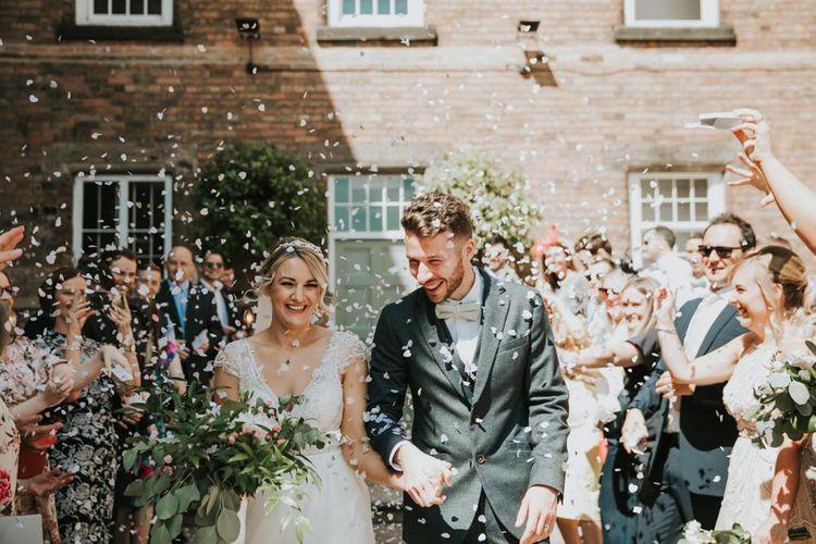 Confetti exit for bride and groom at industrial wedding venue