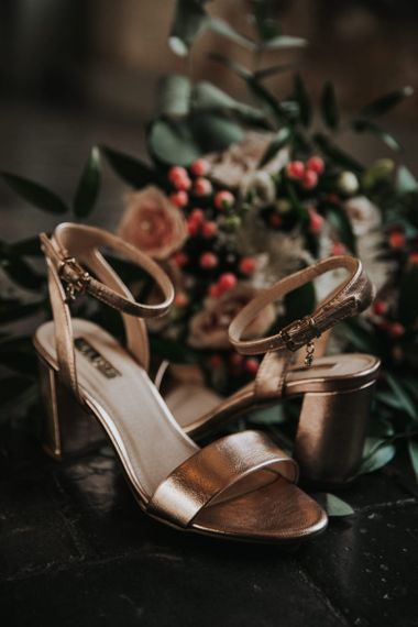 Metallic wedding shoes with Stella York wedding dress