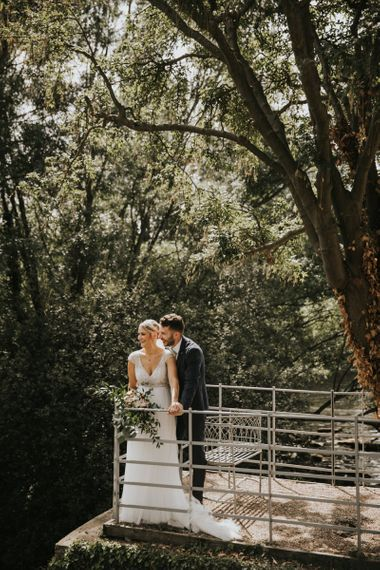 Bride in Stella York wedding dress with groom at industrial wedding
