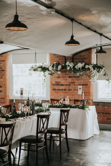Hanging flower installation above top table