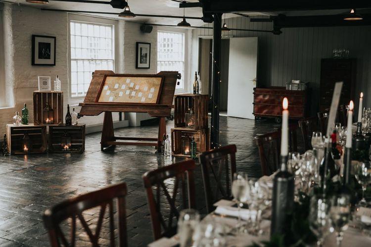 Wedding decor with map theme table plan