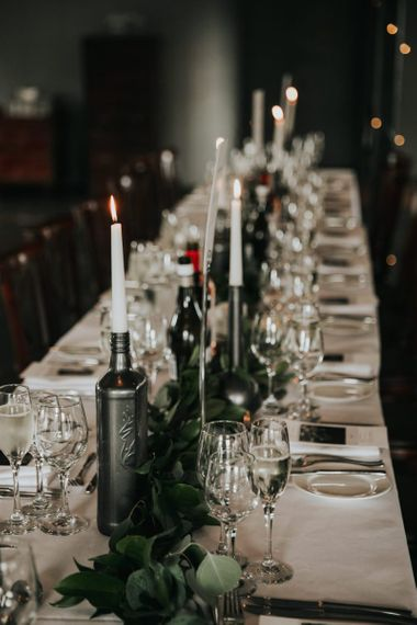 Wedding table decor with candles and foliage