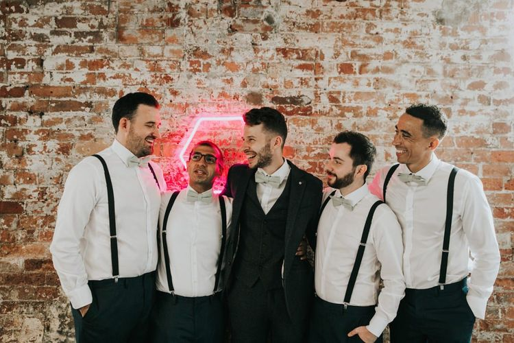 Groomsmen in matching shirt and braces