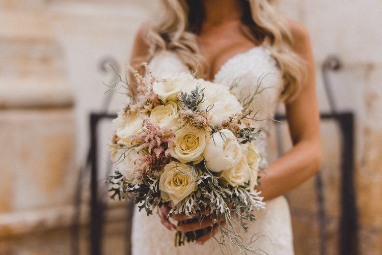 White roses bouquet with Essense of Australia wedding dress