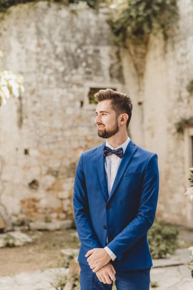 Blue wedding suit for groom with bow tie