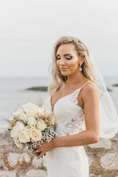 Essense of Australia wedding dress with hair down and drop earrings