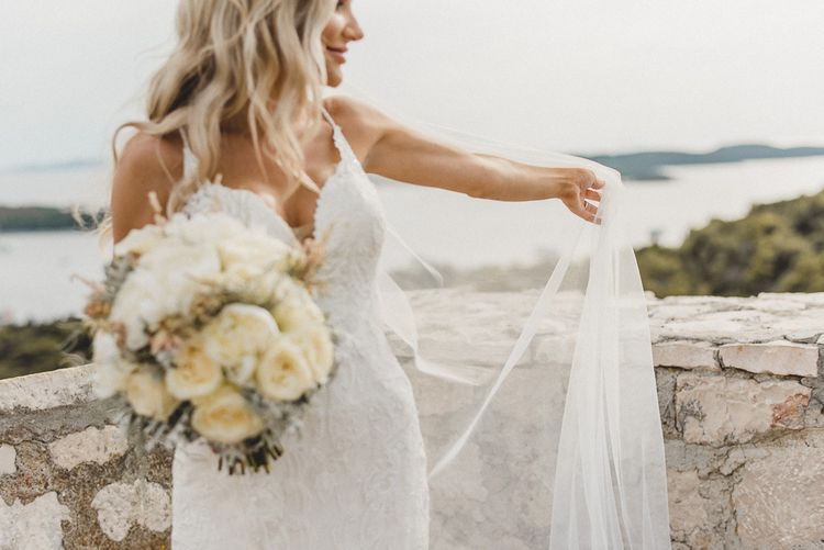 Essense of Australia wedding dress with white rose bouquet