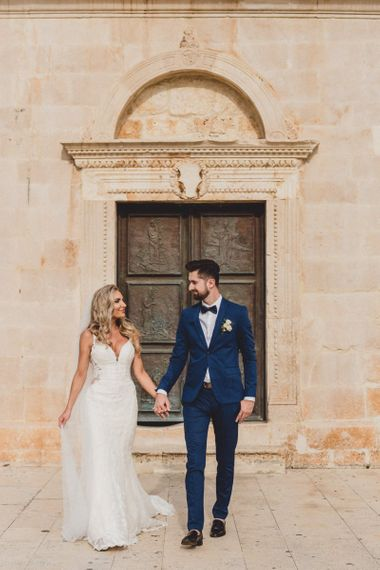 Bride in Essense of Australia wedding dress with groom in blue suit