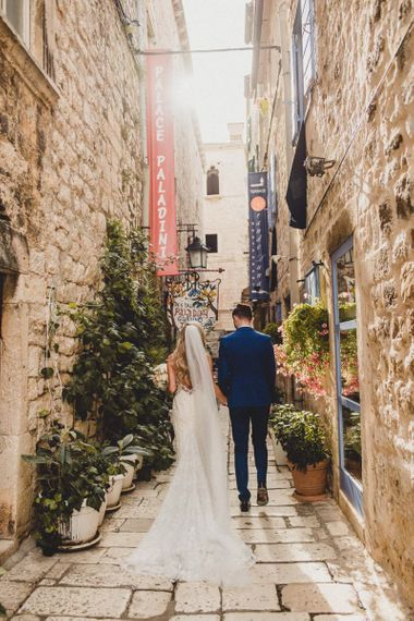 Bride and groom walk through streets of Hvar