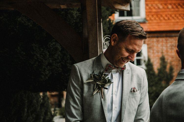 Groomsman in Blazer, Chinos, Braces & Bow Tie | Rustic, Boho, Outdoor Summer Garden Wedding at Herons Farm, Berkshire | Carla Blain Photography