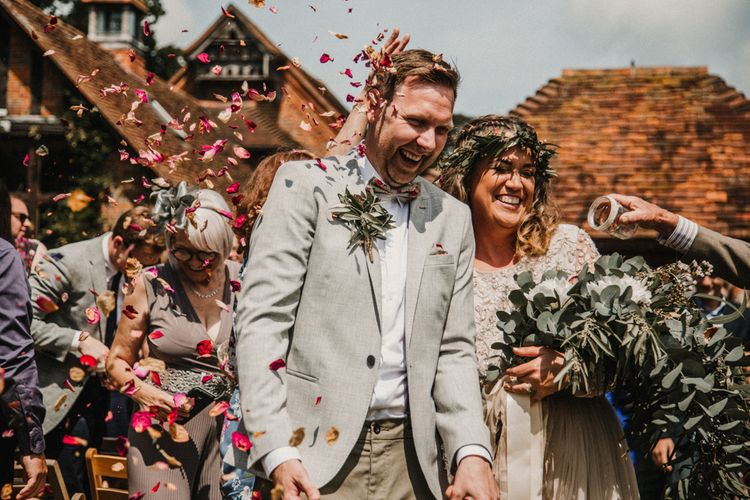 Confetti Moment | Boho Bride in Sequin & Tulle Needle & Thread Gown | Groom in Chinos, Braces & Bow Tie | Rustic, Boho, Outdoor Summer Garden Wedding at Herons Farm, Berkshire | Carla Blain Photography