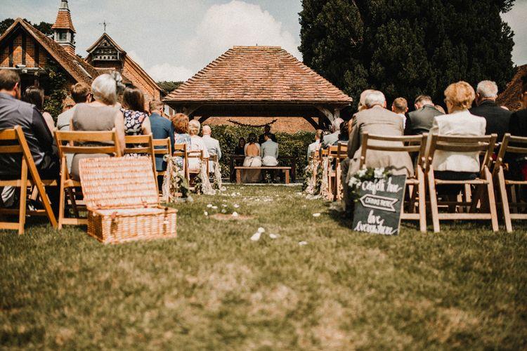 Wedding Ceremony | Boho Bride in Sequin & Tulle Needle & Thread Gown | Groom in Chinos, Braces & Bow Tie | Rustic, Boho, Outdoor Summer Garden Wedding at Herons Farm, Berkshire | Carla Blain Photography