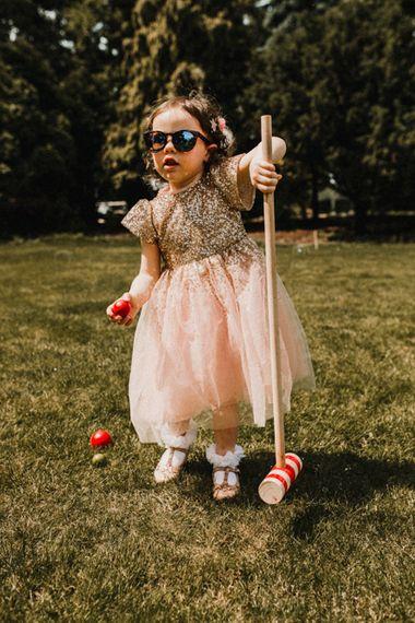 Flower Girl in Blush Pink Dress | Lawn Games | Rustic, Boho, Outdoor Summer Garden Wedding at Herons Farm, Berkshire | Carla Blain Photography