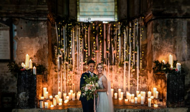 Same sex Asylum Chapel wedding with candles and fairy lights