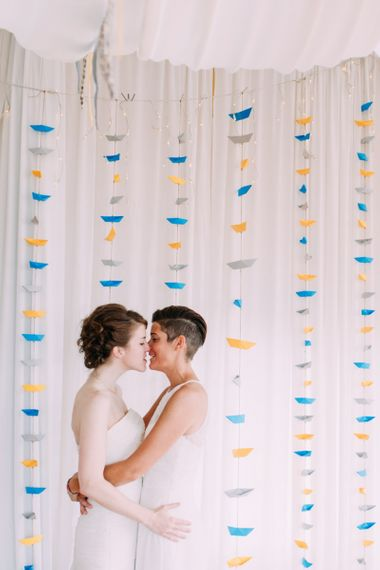 Lesbian wedding with origami boat backdrop