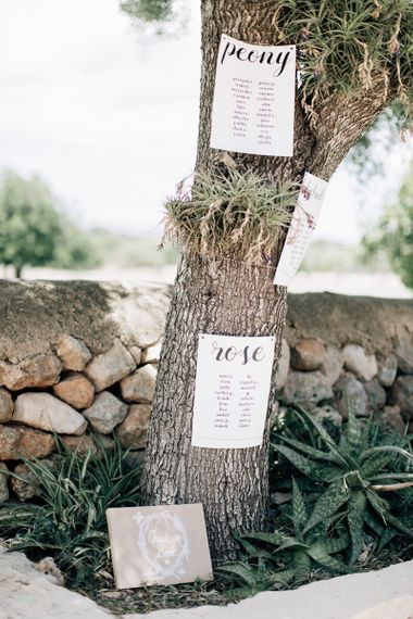 Wedding table plan tied to a tree
