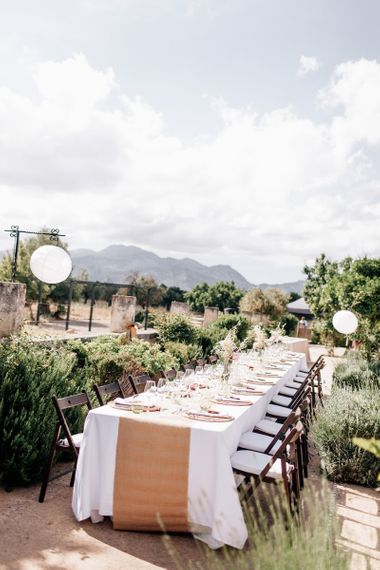 Outdoor Spanish reception with white paper lanterns