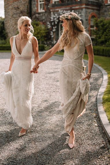Lesbian wedding with brides in Watters wedding dresses
