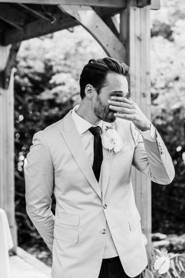 Emotional groom as his bride walks down the aisle